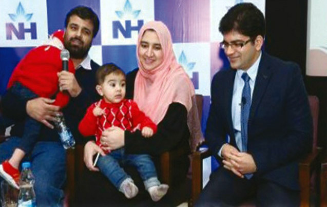 Pakistani infant becomes youngest bone marrow donor in India Zeenia (with father), Rayan (in mother's lap) and Dr. Sunil Bhat.